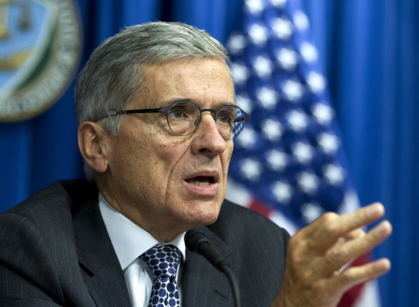 Federal Communications Commission Chairman Tom Wheeler has proposed that the agency regulate Internet service like a public utility. He is pictured at a news conference in Washington in October.