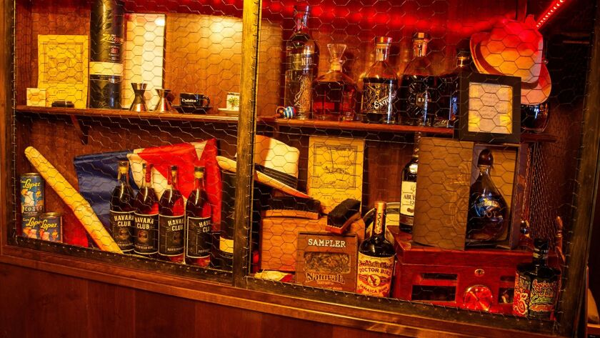 A rustic display case in Havana 1920 restaurant features rare Cuban rums and other historical items.