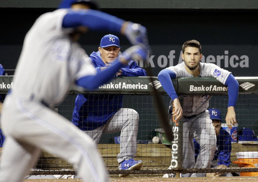 Kansas City Royals manager Ned Yost, left rear, and Eric Hosmer watch from the dugout as Jarrod Dyson, front left, swings during the ninth inning of a baseball game against the Baltimore Orioles in Baltimore, Wednesday, June 8, 2016. Baltimore won 4-0. (AP Photo/Patrick Semansky)