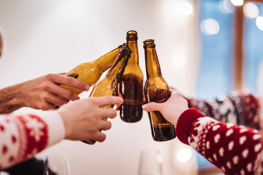 christmas friends toasting beer at home