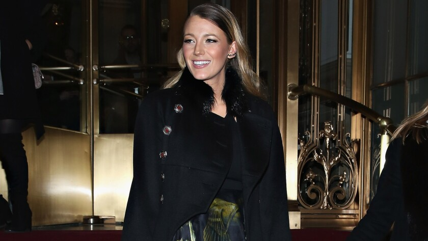 Actress Blake Lively leaves the Marchesa fashion show during Mercedes-Benz Fashion Week Fall 2015 at St. Regis Hotel on Feb. 1 in New York City.