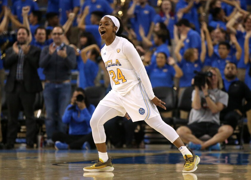 UCLA's Japreece Dean celebrates after making a three-pointer in overtime against Oregon State on Feb. 17 at Pauley Pavilion.