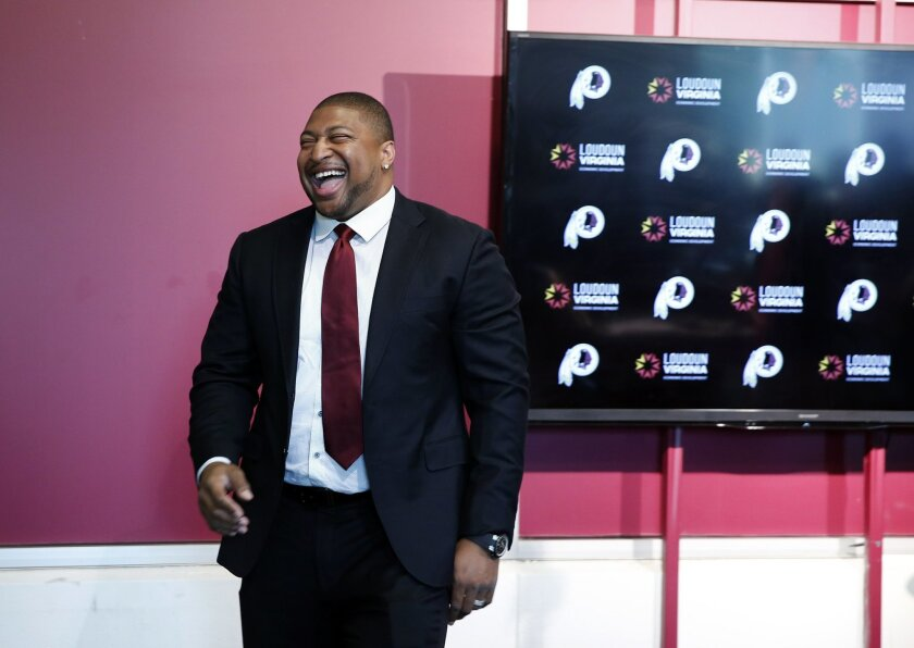 Former Washington Redskins defensive end Stephen Bowen smiles after speaking during a media availability at the team's NFL football training facility at Redskins Park, Wednesday, June 1, 2016 in Ashburn, Va. The Redskins announced Bowen had retired from the NFL earlier Wednesday, after 10 years in