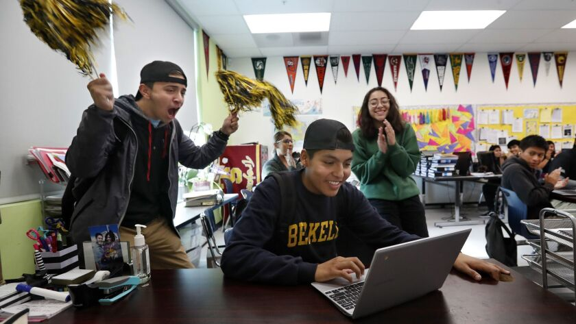 LOS ANGELES, CA-NOVEMBER 28, 2018: Bryan Hernandez, 17, center, is cheered on by Jason Gutierrez, 17
