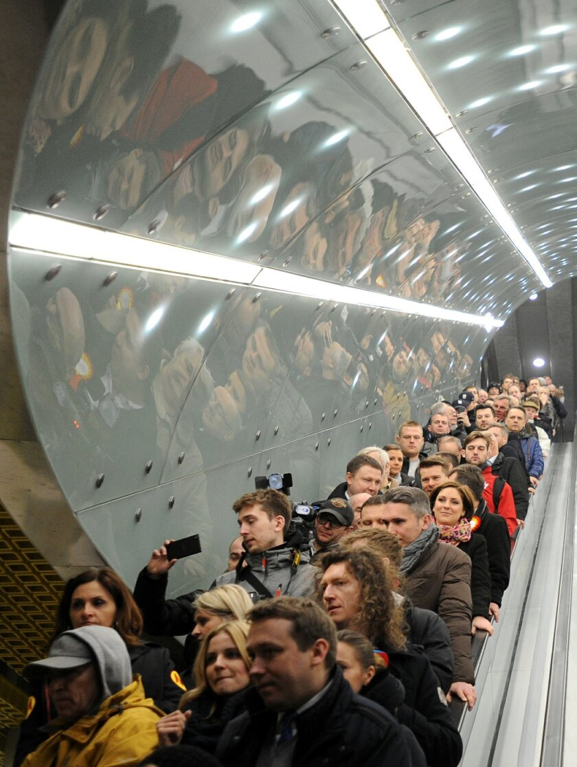 First passangers arrive at the Swietokrzyska station to take a ride on Warsaw's second subway line as it opens, in Warsaw, Poland, Sunday, March 8, 2015. The 6-kilometer (4-mile) line runs East-West and some 8 meters (26 feet) under the Vistula river, linking the eastern Praga district with the dow
