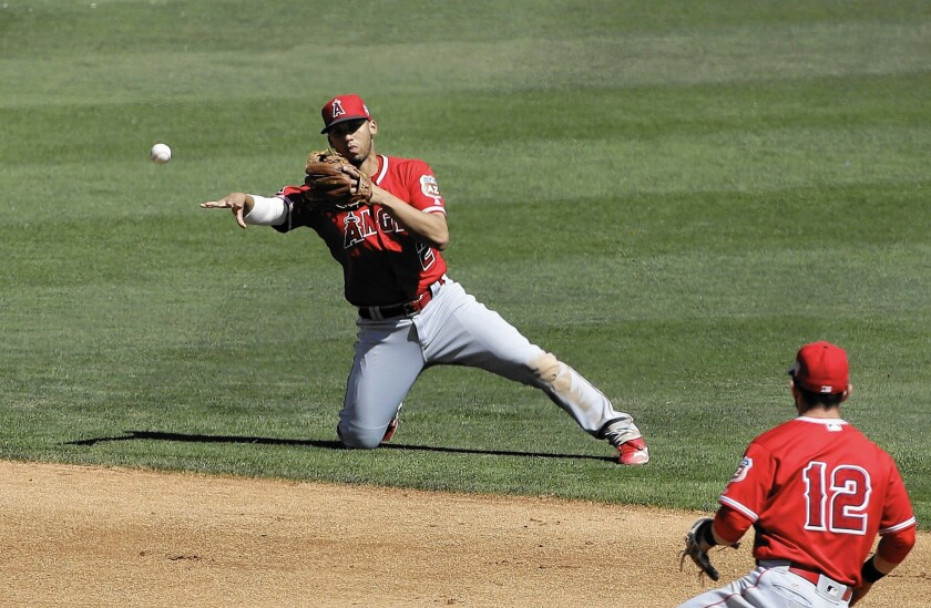 The Angels' Andrelton Simmons makes a play against the White Sox during a March spring training game in Glendale, Ariz.