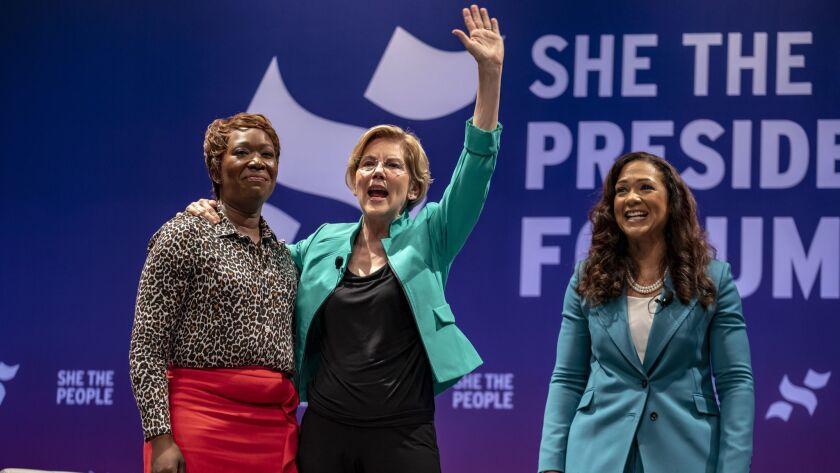 From left, MSNBC host Joy Reid, Democratic presidential candidate Sen. Elizabeth Warren and She the People founder Aimee Allison address a crowd Wednesday in Houston.