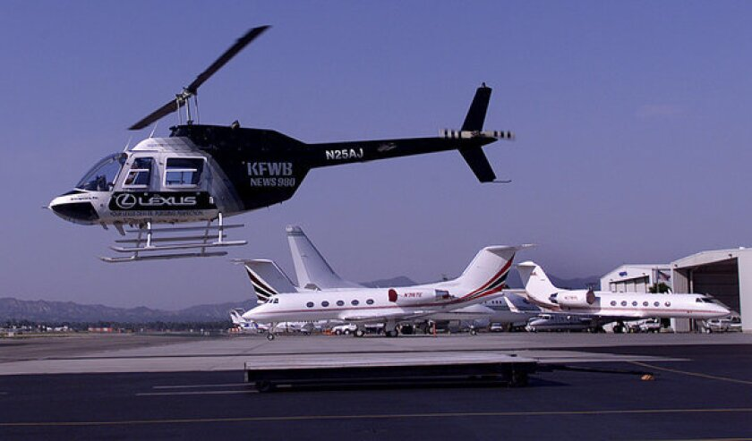 A Bell 206 helicopter used for traffic reports by KFWB-AM takes off from Van Nuys Airport. Residents across the Los Angeles Basin have been concerned about the noise and safety risks of low-flying helicopters over their neighborhoods and local landmarks.