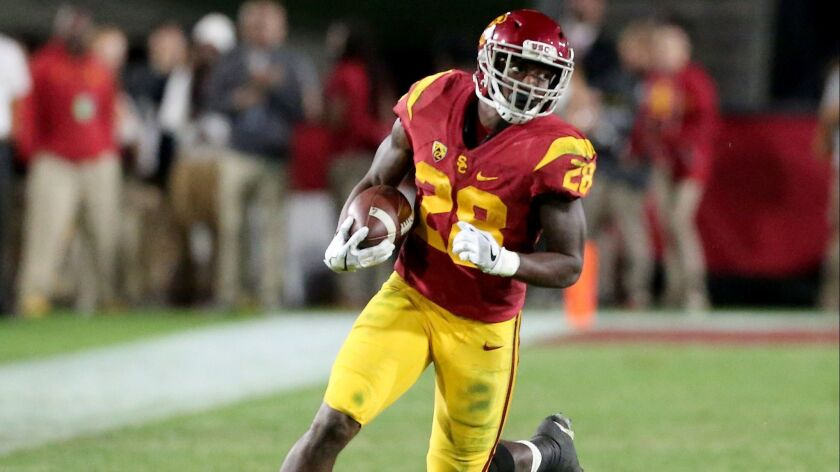 USC running back Aca'Cedric Ware looks for room to run against Cal.