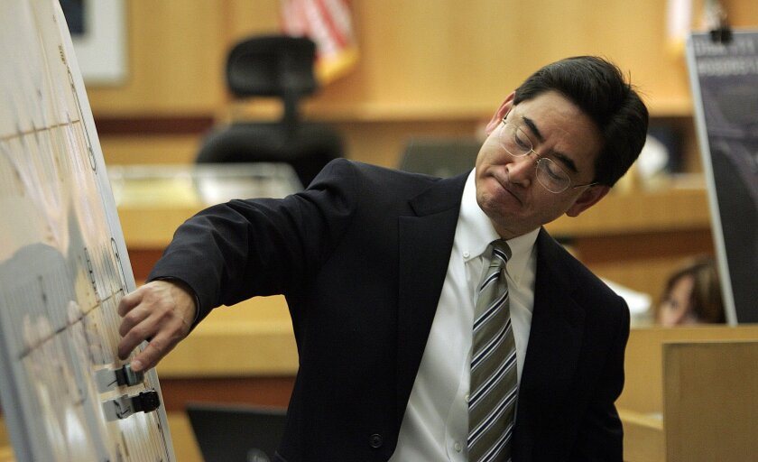 Defense attorney Richard Pinckard used toy cars on magnets to show the positioning of Frank White and Rachel Silva's vehicles during the 2008 confrontation. (John Gastaldo / Union-Tribune)