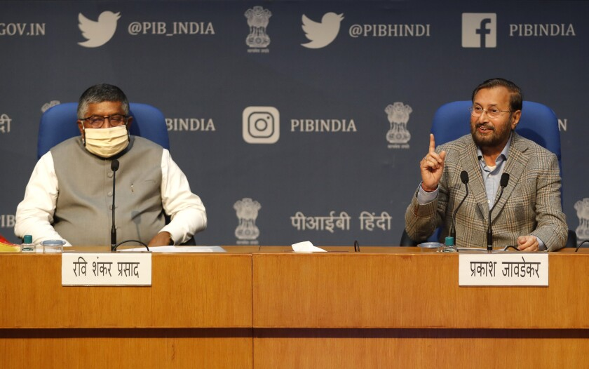 """FILE - In this Thursday, Feb. 25, 2021, file photo, India's Information Technology Minister Ravi Shankar Prasad, left, and Information and Broadcasting Minister Prakash Javadekar address a press conference announcing new regulations for social media companies and digital streaming websites in New Delhi, India. The standoff between the Indian government and Twitter escalated Wednesday, June 16, when the country's technology minister accused the social media giant of deliberately not complying with local laws. Prasad said Twitter has chosen """"the path of deliberate defiance"""" when it comes to following new internet regulations that digital activists have said could curtail online speech and privacy in India. (AP Photo/Manish Swarup, File)"""