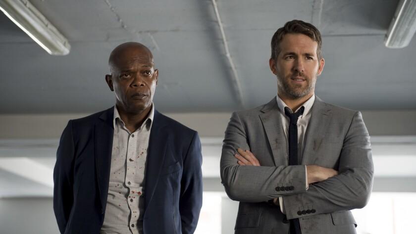 Darius Kincaid (Samuel L. Jackson) and Michael Bryce (Ryan Reynolds) in THE HITMAN'S BODYGUARD.