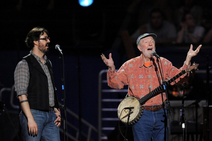 FILE - In this May 3, 2009 file photo, musician Pete Seeger, right, and grandson Tao Rodríguez-Seeger perform at a benefit concert celebrating Seeger's 90th birthday at Madison Square Garden in New York. A five-day festival honoring the late folk singer will feature music, film and remembrances in