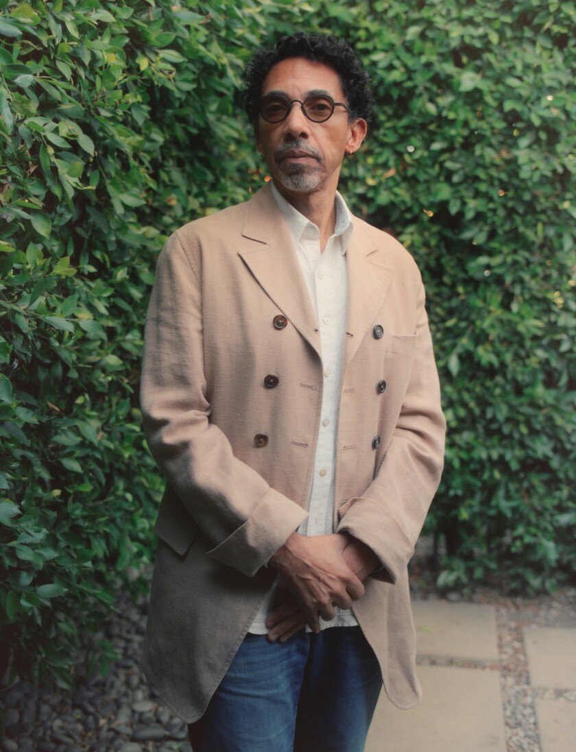Historian/writer Robin D.G. Kelley stands outdoors in front of a shrub.