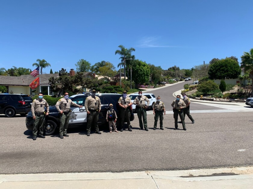 Drew Carlin (center) with sheriff's deputies at the North Coastal Station on El Camino Real.
