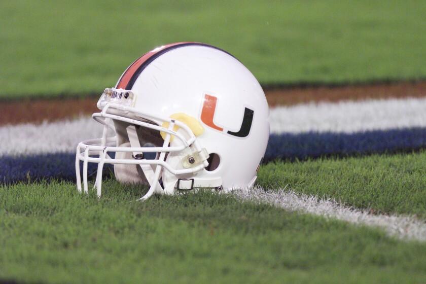 University Of Miami helmet lays on the field.