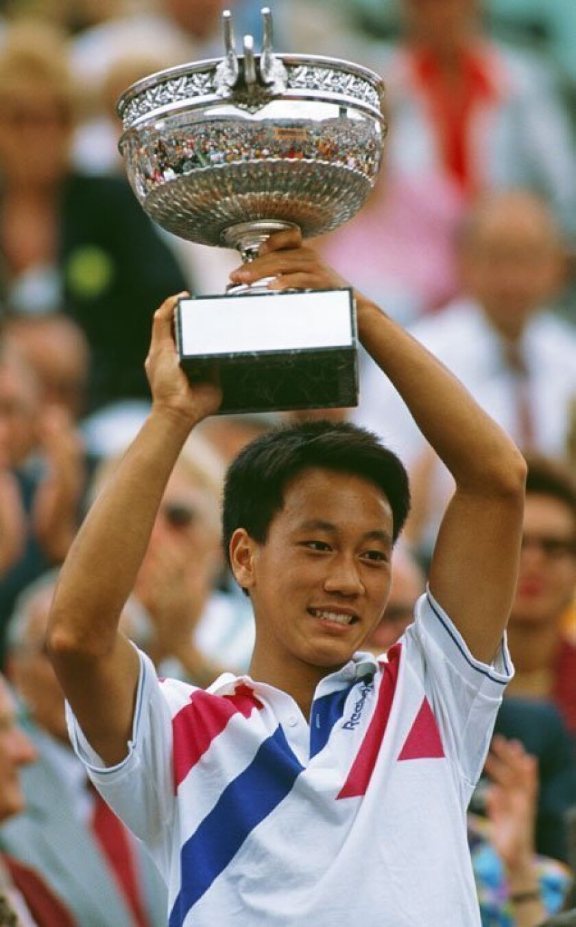 Michael Chang fought through cramps to win a marathon French Open match in 1989 and would become the youngest male champ of a tennis Grand Slam event. (1989 file photo / Getty Images)