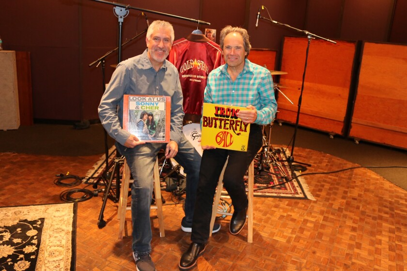 Brad Ross, left, and Jonathan Rosenberg display album covers for music that was recorded in Gold Star Recording Studios, which was co-founded and operated by Ross' father, the late Stan Ross. The son and Rosenberg co-wrote a musical that will staged by the San Diego Repertory Theater in August.
