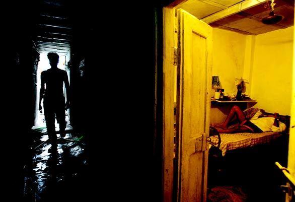 "A man rests in his room in Nehru Nagar, a Mumbai slum where a part of the Oscar-nominated movie ""Slumdog Millionaire"" was filmed. Many of the people in Nehru Nagar hadn't heard of the Oscars, and the neighborhood Hindi-language cinema had no immediate plans to screen the Hindi version of the movie, ""Slumdog Crorepati."""