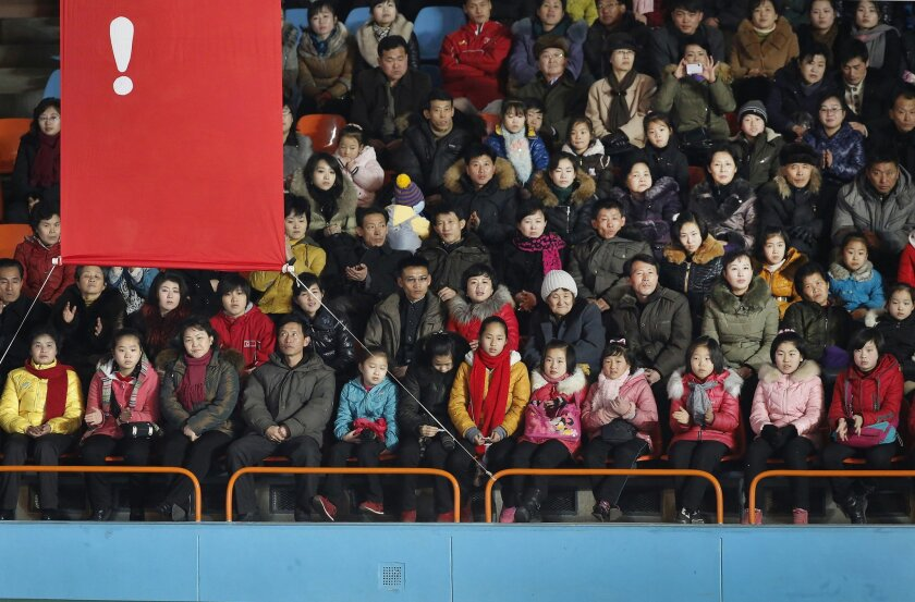 """In this Tuesday, Feb. 16, 2016, photo, North Koreans sit behind a banner with an exclamation mark during a figure skating performance held as part of celebrations on the """"Day of the Shining Star"""" or birthday anniversary of late North Korean leader Kim Jong Il in Pyongyang, North Korea. While the re"""