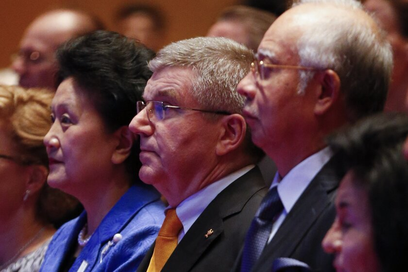 From left to right, Chinese Vice Premier, head of the delegation of the Beijing 2022 Bid Committee, Liu Yandong, President of the International Olympic Committee (IOC) Thomas Bach, Malaysia's Prime Minister Najib Razak, stand during the opening ceremony of IOC in Kuala Lumpur, Malaysia,Thursday, July, 30, 2015. Malaysia is hosting the 128th International Olympic Committee executive board meeting where the vote for the host cities of the 2022 Olympic Winter Games and for the 2020 Youth Olympic Winter Games will take place. (AP Photo/Vincent Thian)
