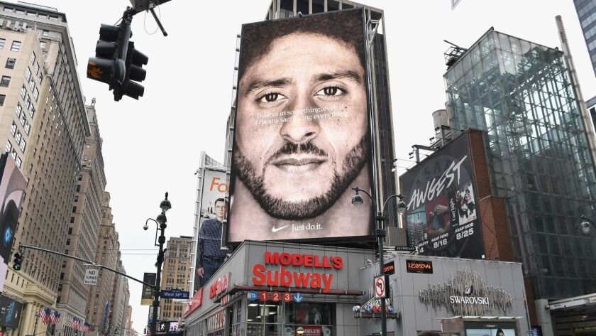 A Nike ad featuring former NFL quarterback Colin Kaepernick is shown in New York.