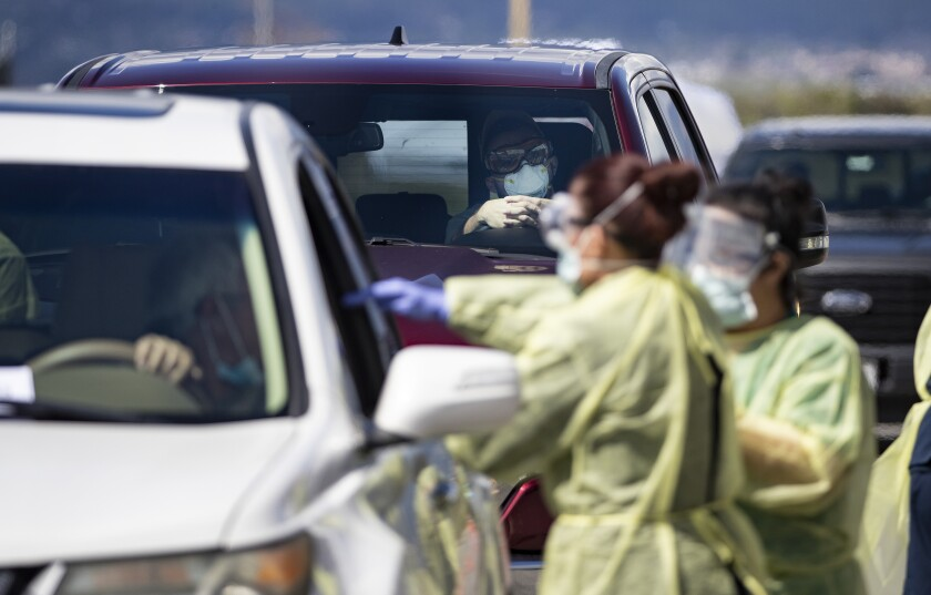 Riverside County medical personnel at a drive-through testing facility