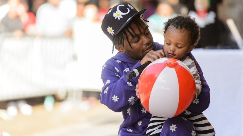 Rapper Madeintyo brings out his son during performance at .Paak House in the Park on Dec. 8, 2018, at MacArthur Park in L.A.