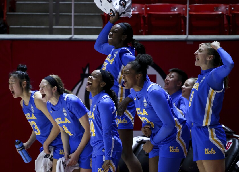 Players on UCLA's bench cheer during the final moments of the Bruins' 84-54 victory over Utah on Jan. 10, 2020.
