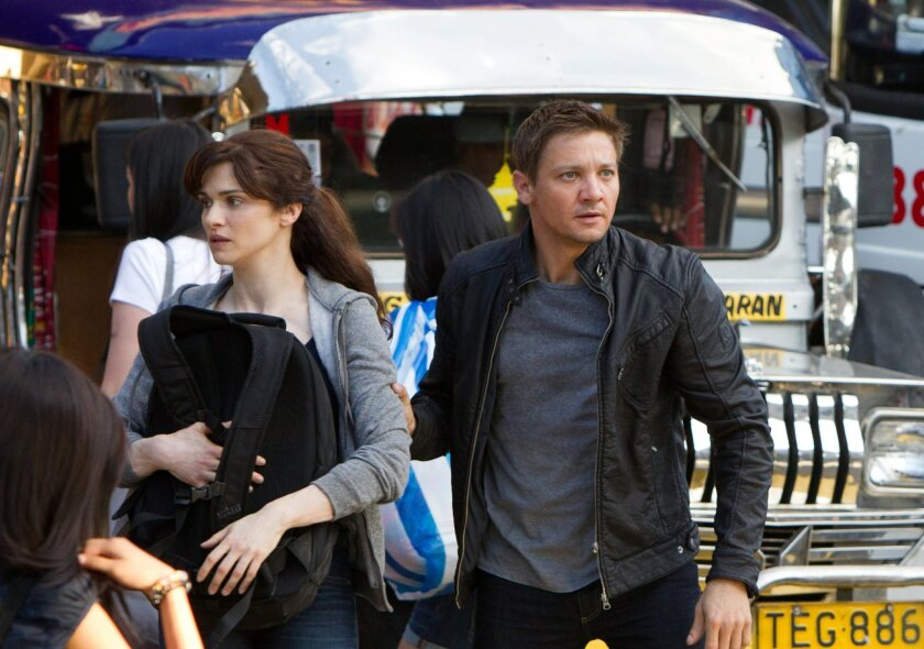 """Rachel Weisz and Jeremy Renner star in the next chapter of the espionage franchise """"The Bourne Legacy."""" Mary Cybulski  © 2012 Universal Studios"""