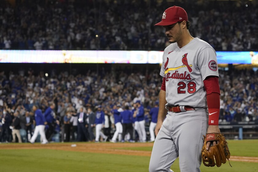 St. Louis Cardinals third baseman Nolan Arenado (28) leaves the field after the Los Angeles Dodgers won a National League Wild Card playoff baseball game 3-1 Wednesday, Oct. 6, 2021, in Los Angeles. (AP Photo/Marcio Jose Sanchez)