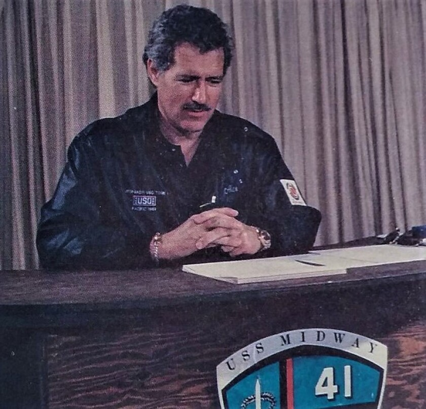 A young Alex Trebek aboard the U.S.S. Midway aircraft carrier while on a USO tour in 1988.