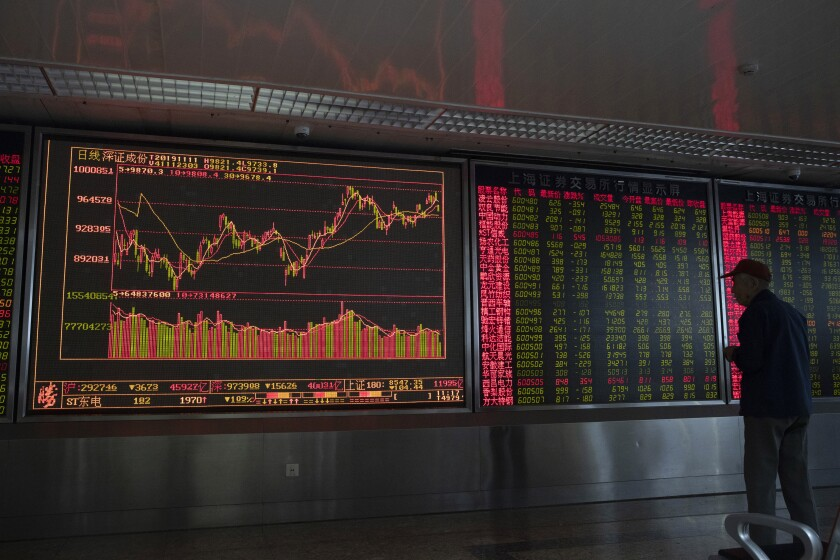 An investor monitors stock prices at a brokerage in Beijing Monday, Nov. 11, 2019. Shares declined Monday in Asia as investors watched for the latest developments in the China-U.S. trade war sage. (AP Photo/Ng Han Guan)