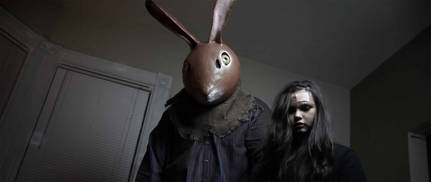 """Jonathan Holbrook, in a brown rabbit mask, and Sanae Loutsis in """"Beloved Beast."""""""