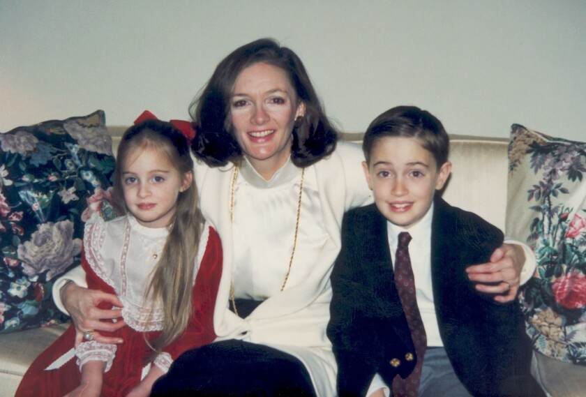Ted Adderley is pictured as a boy with his mother, Mary Beth, and sister, Elizabeth.