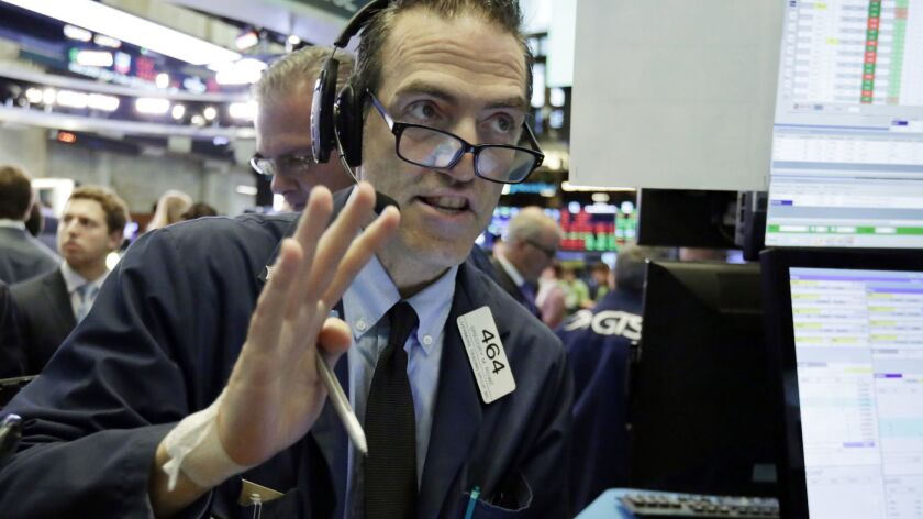Trader Gregory Rowe works on the floor of the New York Stock Exchange on July 25.