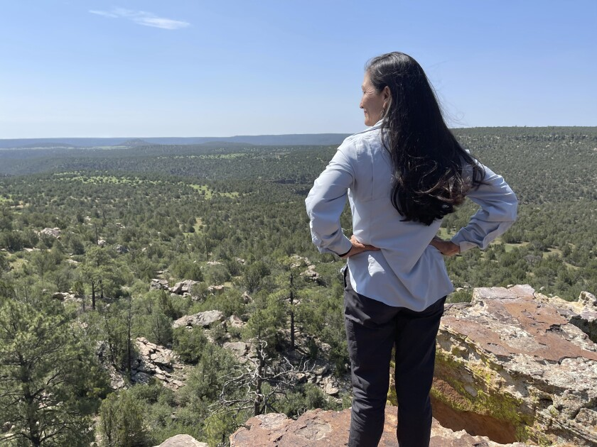 In this Saturday, July 17, 2021 photo released by the Office of the Secretary Department of the Interior, Secretary of the Interior Deb Haaland looks out at the Sabinoso Wilderness in Las Vegas, N.M., after accepting a land donation from the Trust for Public Land to the Bureau of Land Management. The donation increases the size of the Sabinoso Wilderness in northeastern New Mexico by nearly 50%. (Felicia A. Salazar/U.S. Department of the Interior via AP)