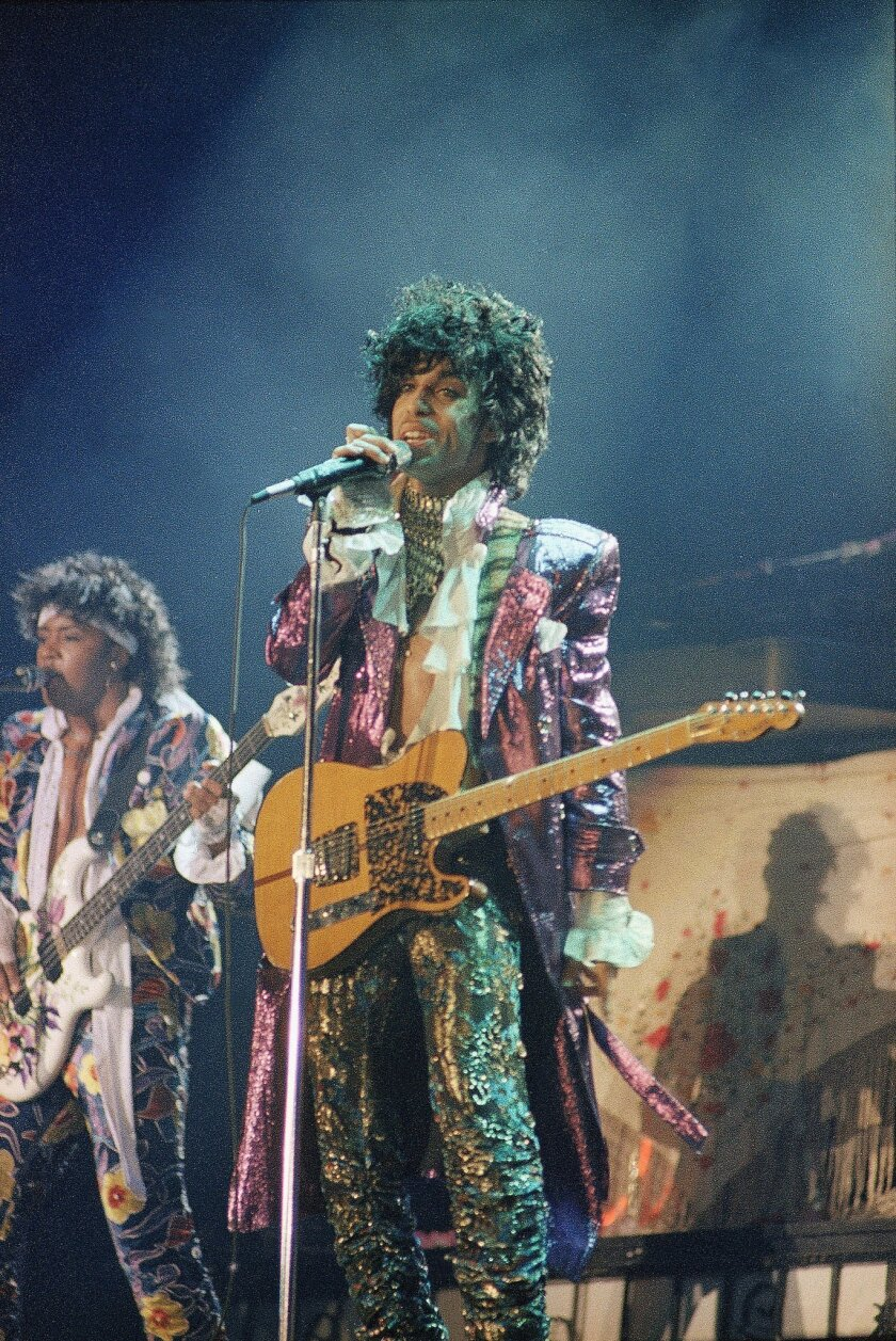 FILE - In this 1985 file photo, singer Prince performs in concert. The Revolution, the band that helped catapult Prince to international superstardom is reuniting in his memory. The Revolution, which backed up Prince in the 1980s, will play two shows Sept. 2-3, 2016, at First Avenue, the downtown M