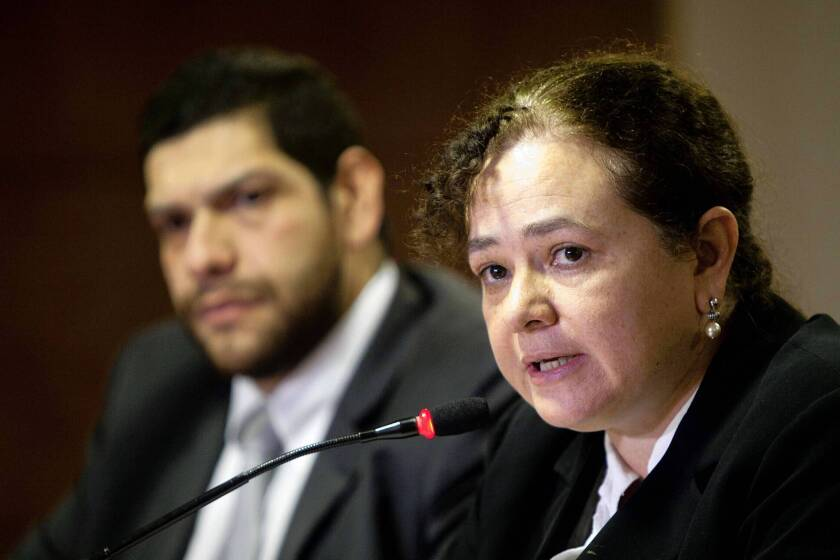 Guatemala official takes on nation's ugly past, violent present