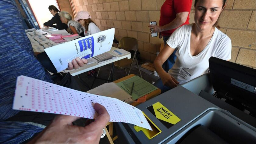 A woman votes in Hermosa Beach on Tuesday. California voters considered 11 statewide ballot measures, on topics ranging from rent control to daylight saving time.