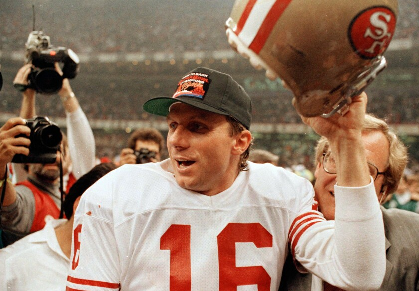 49ers quarterback Joe Montana celebrates after winning his fourth Super Bowl on Jan. 28, 1990.