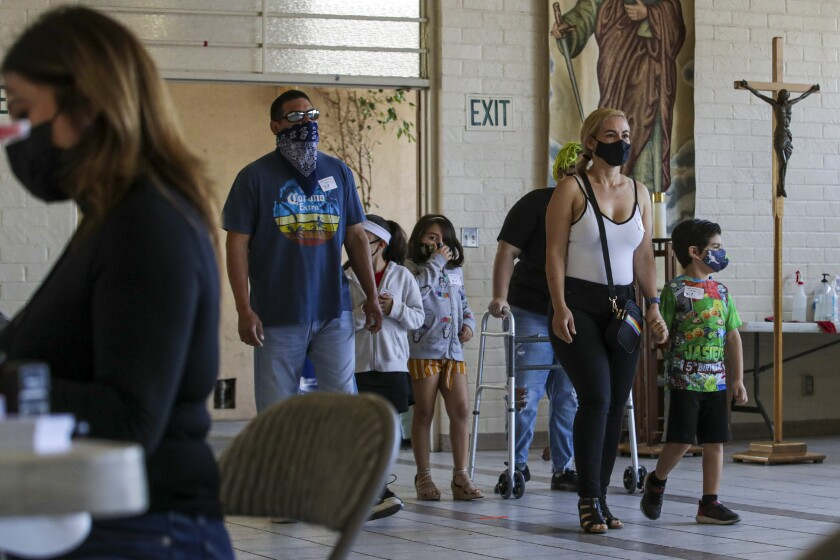 People arrive at a COVID-19 vaccination clinic at St. Patrick's Catholic Church in L.A.