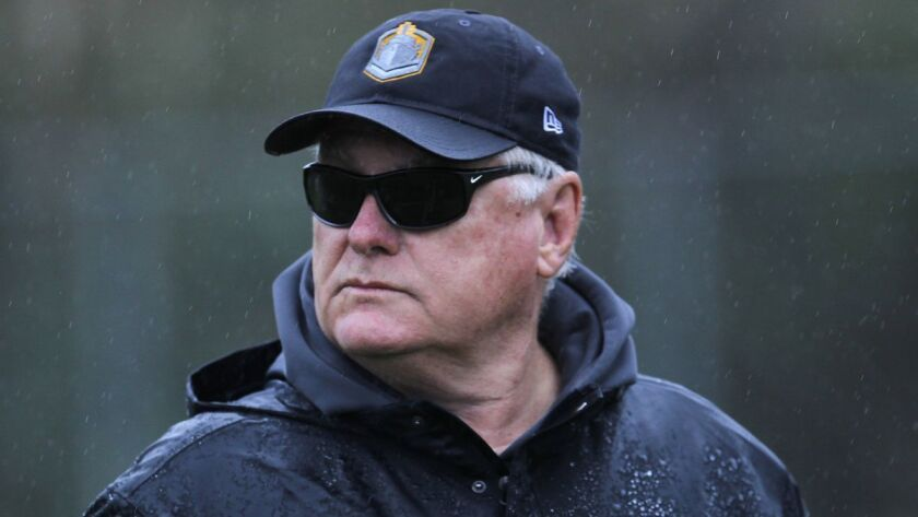 San Diego Fleet coach Mike Martz oversees practice in the rain Tuesday in Mission Valley.