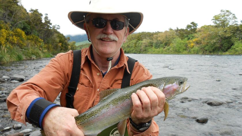 Bill Heard and the rainbow trout he caught within minutes of casting a line into the Tongariro River