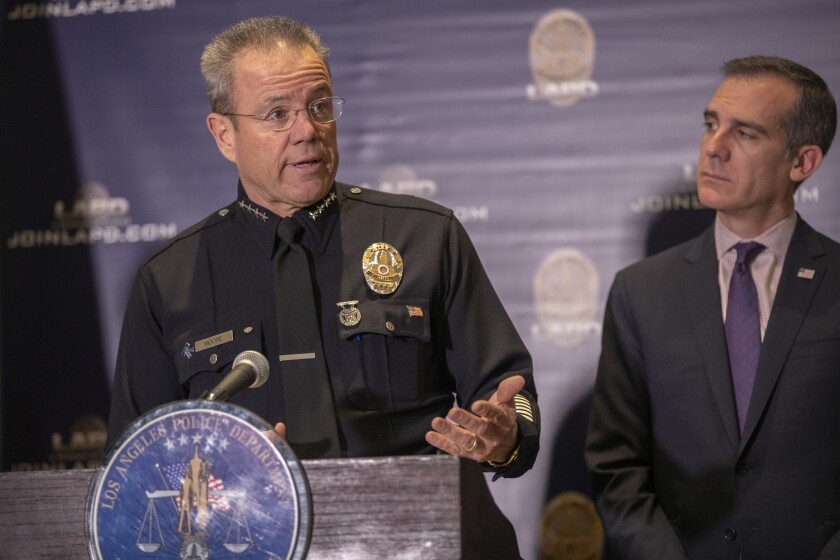 Mayor Eric Garcetti and LAPD Chief Michel Moore at a media briefing on crime statistics in January  2019.