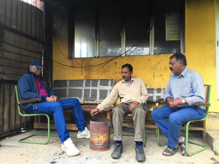 "Roy Rolen, left, with other security guards outside the Hindustan Photo Films factory in India. ""We're tired of sitting here all day and telling the same old stories about those golden years. That is over and it's time to get out,"" Rolen says."