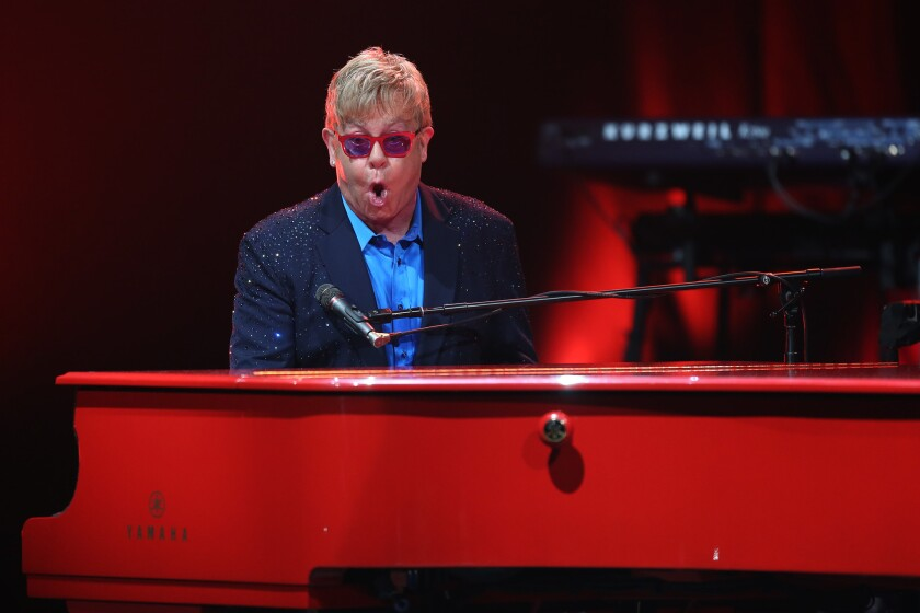 Elton John performs Wednesday night at the Wiltern in Los Angeles.