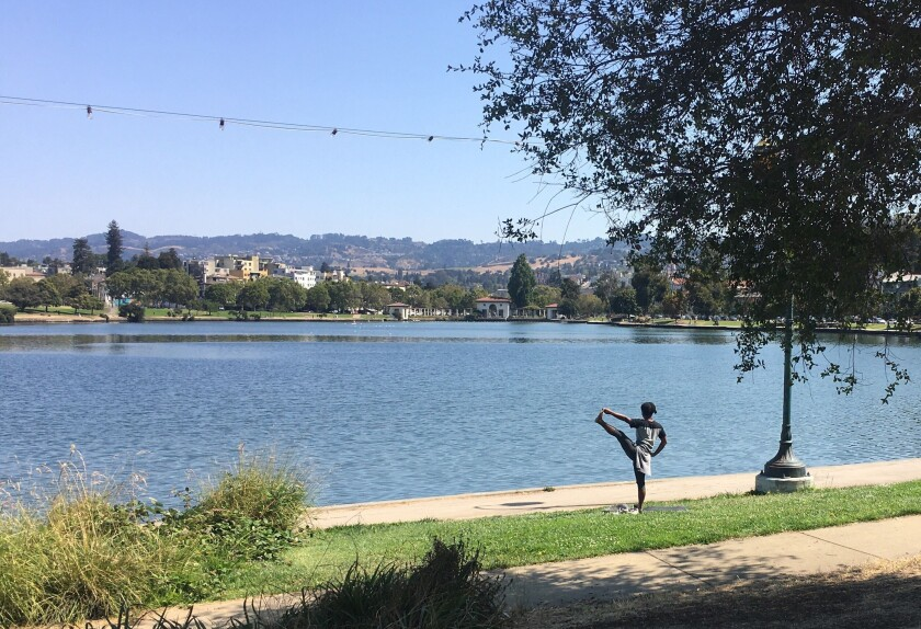 After authorities discouraged crowds over the weekend, Oakland's Lake Merritt returned to normal Monday morning