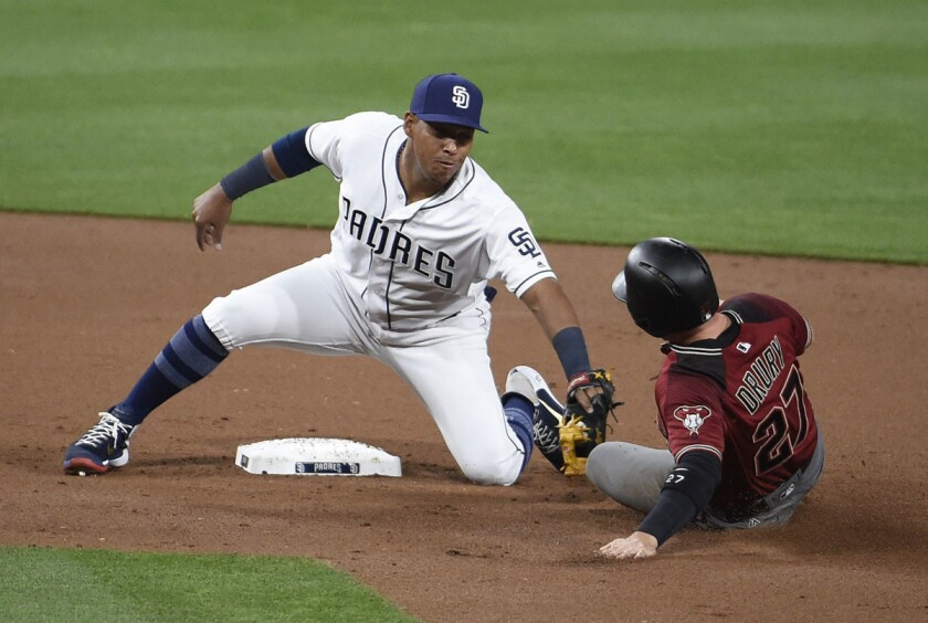 Yangervis Solarte #26 of the San Diego Padres tags out Brandon Drury #27 of the Arizona Diamondbacks as he tries to steal second base during the second inning of a baseball game at PETCO Park on April 19, 2017. (Denis Poroy/Getty Images)