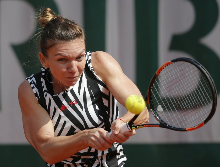 Romania's Simona Halep returns in her third round match of the French Open tennis tournament against Japan's Naomi Osaka at the Roland Garros stadium in Paris, France, Friday, May 27, 2016. (AP Photo/Christophe Ena)